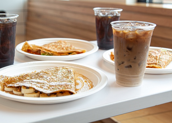 Crepes and iced coffee by Curate Your Feed Photography