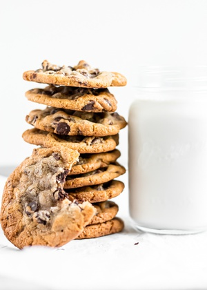 Stack of cookies and oat milk by Curate Your Feed Photography